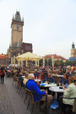 People in street cafe at Old Town square (Staromestska) in Pragu Royalty Free Stock Photo