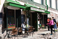 People in the street cafe in Vyborg, Russia Royalty Free Stock Photography