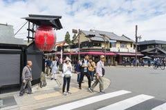 People street corner Arashiyama Japan. People in street corner waiting to cross the street in Arashiyama. Kyoto, Japan Royalty Free Stock Images