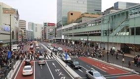 People for street crossing at Shinjuku Express Bus Terminal. Tokyo, Japan - April 9, 2016: People for street crossing at Shinjuku Express Bus Terminal. The bus stock video