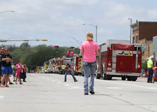 People in the street with fire engines in a parade in small town America Royalty Free Stock Photography