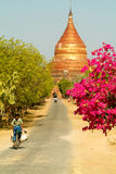 People on the street in front of Dhammayazika pagoda Royalty Free Stock Image