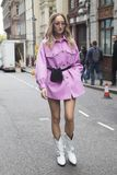 People on the street during the London Fashion Week. stock images