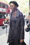 People on the street during the London Fashion Week. stock photo