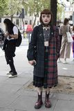 People on the street during the London Fashion Week. stock photos