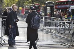 People on the street during the London Fashion Week. stock photography