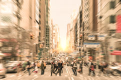 People on the street on Madison Avenue in Manhattan downtown before sunset in New York city - Commuters walking on zebra crossing. People walking on the street royalty free stock photo