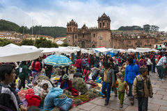 People in a street market in Cuzco, Peru. Cuzco, Peru - December 24, 2013: People in a street market in Cuzco, Peru Stock Images