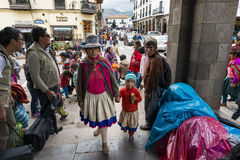 People in a street market in Cuzco, Peru. Cuzco, Peru - December 24, 2013: People in a street market in Cuzco, Peru Royalty Free Stock Images