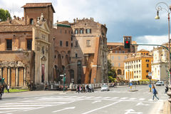 People on  street near the picturesque ancient building in Rome Stock Images