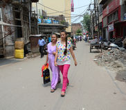 People on street in Old Delhi, India. Indian women walking on street in Old Delhi, India royalty free stock photos