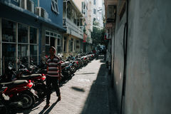 People on the street ride motorcycles in the city of Male, the capital of the Maldives Royalty Free Stock Photography