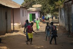 People in a street of a slum in the city of Bissau, in Guinea Bissau Stock Photo