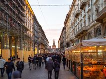 People on street Via Dante in Milan in evening royalty free stock images