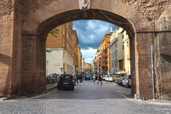 People on street Via del Mascherino in Rome. Gate in the wall, e Royalty Free Stock Photos