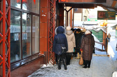 People on the street wait for opening of shop. Tyumen, Russia. Royalty Free Stock Photo