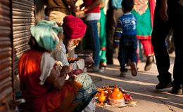 People in the streets of India. Work, play and survival royalty free stock image