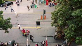 People in the streets on summertime in downtown Eskisehir. Eskisehir, Turkey - July 31, 2017: Top view of people walking in the street on a sunny day in downtown stock video