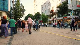 People in the streets on summertime in downtown Eskisehir. Eskisehir, Turkey - July 31, 2017: Crowd of people walking at the center of the city on a sunny day stock video footage