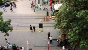 People in the streets on summertime in downtown Eskisehir. Eskisehir, Turkey - July 31, 2017: Top view of people walking in the street on a sunny day in downtown stock footage