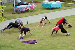 People Stretch Following Fitness Boot Camp Workout Royalty Free Stock Photo