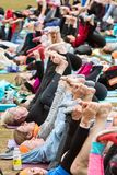 People Stretch Legs In Huge Atlanta Outdoor Group Yoga Class royalty free stock photo