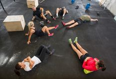 People Stretching in Cross Training Box Stock Images