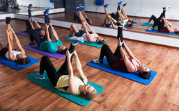 People stretching in dance hall Stock Images