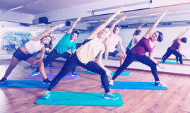 People stretching in dance hall Royalty Free Stock Photography