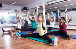 People stretching in dance hall Stock Photos