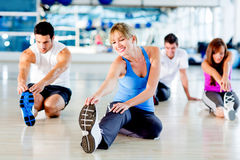 People stretching at the gym Stock Photography