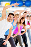 People stretching at the gym Stock Image