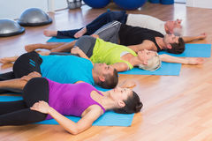 People stretching legs in fitness studio Stock Photography