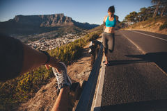 People stretching after morning run Royalty Free Stock Image