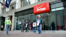 People with strike placard near Verizon wireless, Boston, USA, stock video