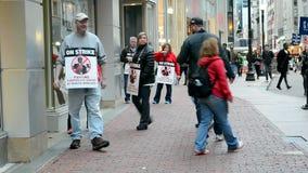 People with strike placard, Verizon Wireless office, Boston, USA, stock footage
