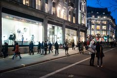 People stroll on a Saturday in Oxford Circus in London, UK royalty free stock images