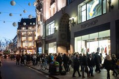 People stroll on a Saturday in Oxford Circus in London, UK stock image
