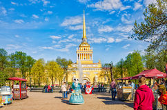 People strolling around in The Alexander Garden near the Admiralty building. Stock Images