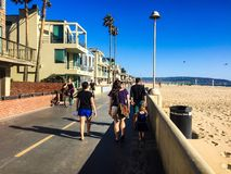 People strolling down the low Angeles beach walkway in the summer Royalty Free Stock Images