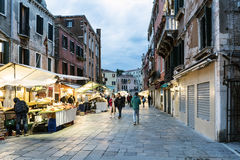 People strolling at dusk on the street called `Rio Tera San Leonardo` and typical street stalls selling fruit Royalty Free Stock Images