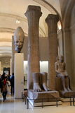 People strolling through the Egyptian exhibit, The Louvre,Paris,France,2016 Royalty Free Stock Images