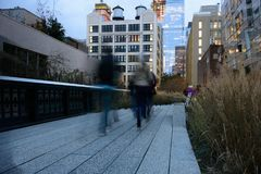 People strolling on the Highline at dusk Stock Photography