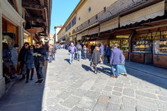 People strolling on the Ponte Vecchio in Florence, Italy Royalty Free Stock Image