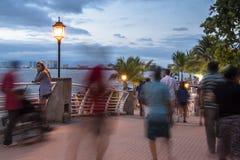 People strolling in Puerto Vallarta. People strolls over a bridge in Puerto Vallarta after the sunset Stock Photo