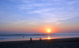 People Strolling at Sunset on Legian Beach, Bali Stock Photo