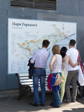 People study the map Gorky Park. Moscow - May 9, 2016: People studying the map to visit and relax in the Gorky Park May 9, 2016, Moscow, Russia royalty free stock photo