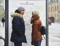 Russia. Moscow. 02-27-2017 People study the metro map on the street. Russia. Moscow. 02-27-2017 . People study the metro map on the street stock images