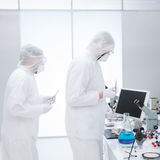 People studying in a chemistry lab Stock Images