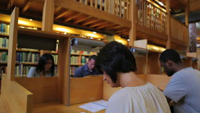 People studying in the library Stock Photos